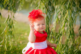 Little girl in a beautiful dress in the park — Stock Photo