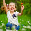 Smiling girl on the meadow with flowers — Stock Photo #25454489