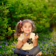 Happy child playing in a spring garden — Stock Photo #25455103