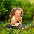 Happy child playing in a spring garden — Stock Photo #25455141