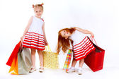 Two shopping sisters, white background — Stock Photo