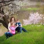 Family in spring garden  — Stock Photo #26907875