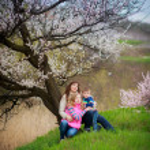Family in spring garden — Stock Photo #26907887