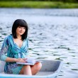 Beautiful pregnant girl in boat — Foto Stock #26916377