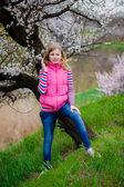 Girl in spring garden — Stock Photo