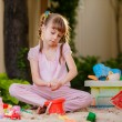 Adorable little girl playing with toys in sandbox — Stock Photo #28120321