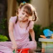 Adorable little girl playing with toys in sandbox — Stock Photo #28123077