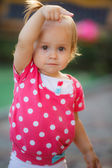 Little girl playing in the garden — Stock Photo