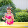 Girl in the pool — Stock Photo