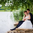 Bride and groom near the pond — Stock Photo