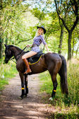 Beautiful blonde with a horse — Stock Photo