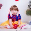 Stock Photo: Little girl snow white with apple