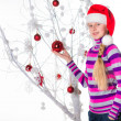 Girl with gifts under the Christmas tree — Stock Photo #28328301