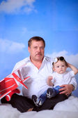 Grandfather and his grandson playing airplane — Stock Photo