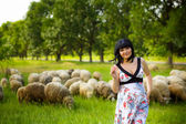 Pregnant woman in the meadow — Stock Photo