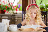 Blonde girl reading an interesting book — Stock Photo