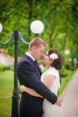 Bride and groom posing together outdoors — Stock Photo