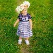 little girl with a wreath on head — Stock Photo