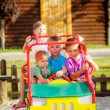 Постер, плакат: Childrens playing with a toy car