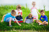 Childrens playing in spring filed — Stock Photo