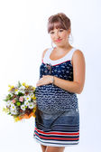 Pregnant woman with flowers — Stock Photo