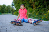 Girl in roller skates at park — Stock fotografie