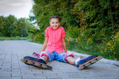 Girl in roller skates at park — Foto Stock
