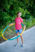 Beautiful teenage girl with hula hoop — Stock Photo