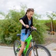 Girl with a bike outdoors — Stock Photo #29644051