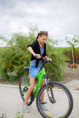 Girl with a bike outdoors — Foto Stock
