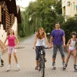 Mother,father and kids running, biking, rollerblading — Stock Photo