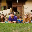 Big happy family lying on the grass — Stock Photo