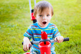Little boy riding on a children's bicycle — Stock Photo