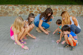 Six people drawing with chalk — Stock Photo
