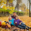 Young family having a picnic in the autumn park — Stock Photo #29895531