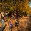 Stock Photo: Young family in autumn park