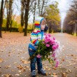 Little boy with a bouquet of flowers — Stock fotografie