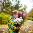 Little boy  with a bouquet of flowers — Stock Photo