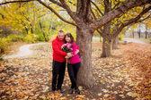 Couple in the autumn park — Stock Photo
