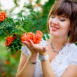 Pregnant woman with rowan berries — Stock Photo