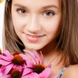 Stock Photo: Girl happily sitting with a small bouquet.