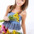 Stock Photo: Young girl with flowers