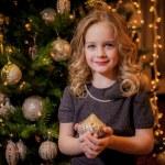 Girl near the Christmas tree — Stock Photo