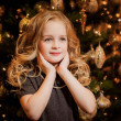 girl near the Christmas tree — Foto de Stock