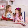 Childrens on the bed with books — Stock Photo #30885455
