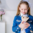 Girl with a toy dog — Stock Photo