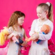 Little girls with dolls — Stock Photo
