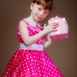 Beautiful little girl with gifts — Stock Photo