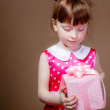 Stock Photo: Beautiful little girl with gifts