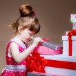 Little girl  looks in a gift — Stock Photo